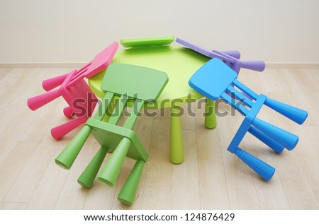 Montessori Kindergarten Preschool Classroom with table and  chairs upside - stock photo
