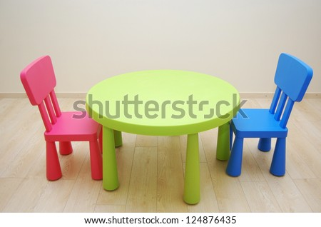 Montessori Kindergarten Preschool Classroom with table and two chairs - stock photo