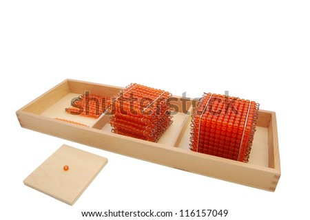 Montessori material - golden beads on white background with container