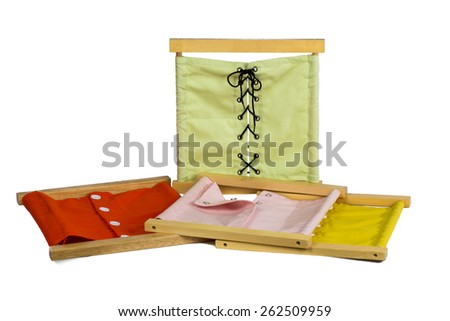 Montessori Materials.  Dressing Frame. - stock photo