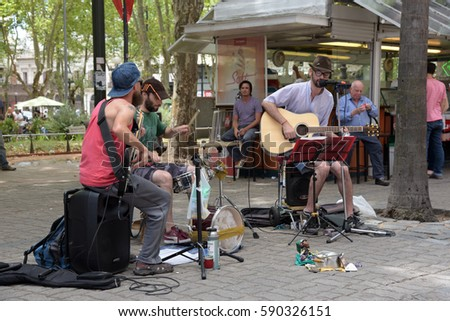 MONTEVIDEO, URUGUAY - JANUARY 22, 2016: unidentified street musician playing rock and roll at pedestrian street in Montevideo,Uruguay at January 22,2016.