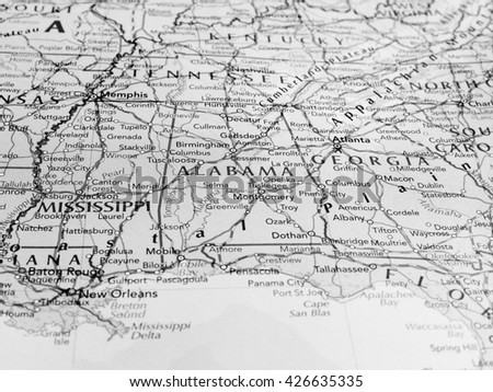 MONTGOMERY, USA - CIRCA MAY 2016: Map of the state of Alabama with selective focus on state name in black and white