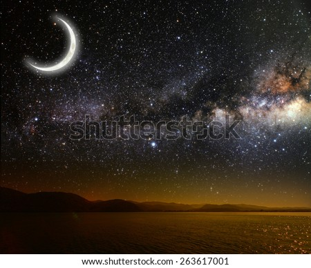 month on a background star sky reflected in the sea. Elements of this image furnished by NASA - stock photo
