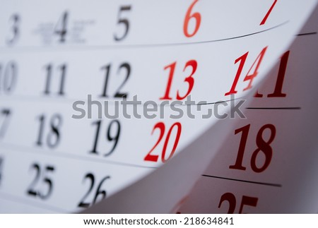 Month on a calendar viewd at an oblique angle with selective focus to the dates and numbers - stock photo