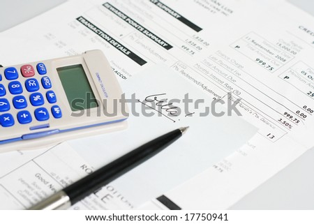 monthly billing statement with pen and calculator