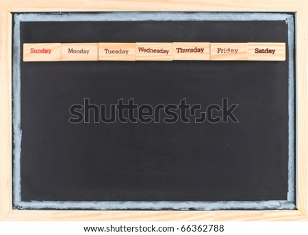 Monthly calendar with week words print on wood on blackboard