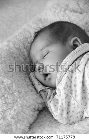 monthly child lies on a white blanket - stock photo