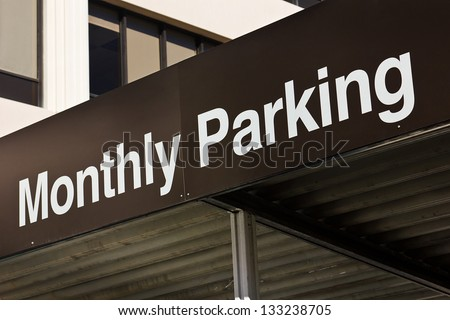 Monthly parking sign sits just above the entrance into the vehicle garage.