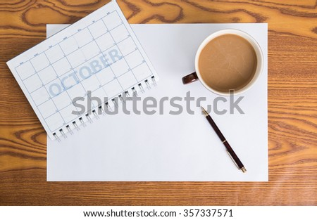 monthly planning schedule on wooden table - stock photo