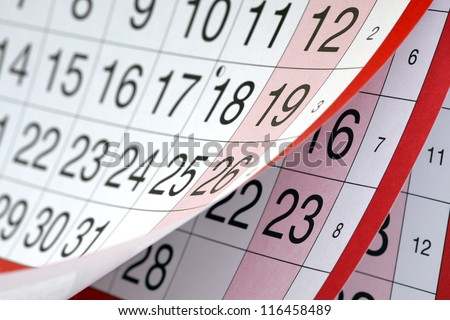 Months and dates shown on a calendar whilst turning the pages - stock photo