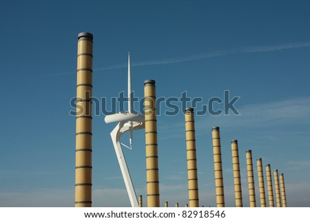 Montjuic tower and lighting columns  Montjuic tower of communications and lighting columns in the Olympic Ring of Barcelona. - stock photo