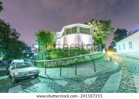 Montmartre road, Paris at night. - stock photo