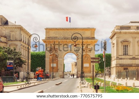 MONTPELLIER, FRANCE - APRIL 27, 2014: Triumphal arch Porte du Peyrou in historical quarter of Montpellier. The arch was built in 1693. The reliefs  show four events from the reign of Louis XIV.