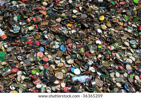 MONTPELLIER, FRANCE - CIRCA 2009: Jar lids lie in a heap at an undisclosed recycling facility circa 2009 in Montpellier. The plastic and metal will be separated and recycled. - stock photo