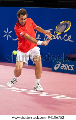 MONTPELLIER, FRANCE - FEBRUARY 1: Richard Gasquet (FRA) defeats Nikolay Davydenko (RUS) at the ATP Sud de France Tennis Open February 1, 2012 in Montpellier, France.