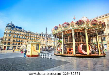 MONTPELLIER, FRANCE - JULY 2: Architecture of Place de la Comedie and the carousel, Montpellier, France on July 2, 2015 in Montpellier. - stock photo