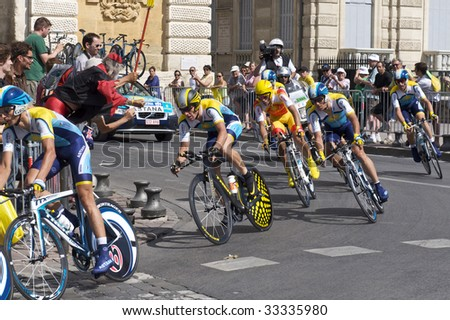 MONTPELLIER, FRANCE - JULY 7: Team Astana and Lance Armstrong take on a corner at Stage 4 of the 2009 Tour de France on July 7, 2009 in Montpellier, France. - stock photo