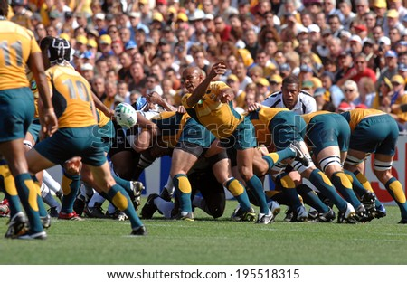 MONTPELLIER, FRANCE-SEPTEMBER 23, 2007: australian rugby player, George Gregan, throws the ball during the match Australia vs Fiji, at the Rugby World Cup, France 2007, in Montpellier. - stock photo