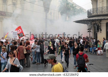 MONTPELLIER, FRANCE - SEPTEMBER 23: Crowds gather to protest against government reform projects of retirement conditions in major cities of France. Arrival at Place Comedie on September 23, 2010 in Montpellier, France - stock photo