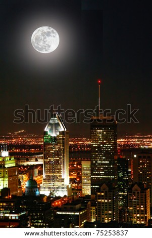 Montreal at night with moon closest to earth - stock photo