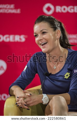 MONTREAL - AUGUST 10: Agnieszka Radwanska of Poland during press conference after her Final game win over Venus Williams at the 2014 Rogers Cup on August 10, 2014 in Montreal, Canada - stock photo