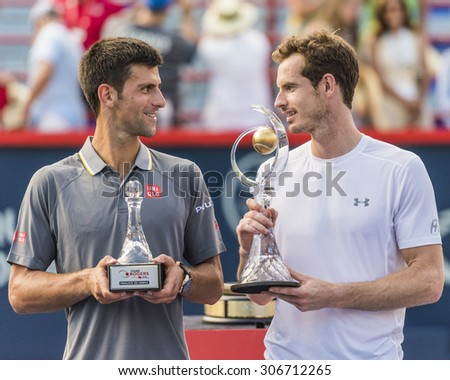 MONTREAL - AUGUST 16:   Andy Murray of Great Britain and Novak Djokovic of Serbia with their trophies at the 2015 Rogers Cup on August 16, 2015 in Montreal, Canada