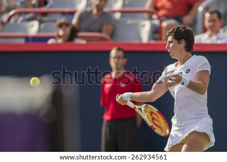 MONTREAL - AUGUST 8: Carla Suarez Navarro of Spain in her quarter final match loss to Venus Williams of USA at the 2014 Rogers Cup on August 8, 2014 in Montreal, Canada