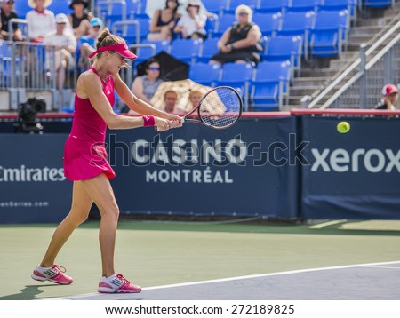 MONTREAL - AUGUST 5: Daniela Hantuchova of Slovakia in her First round match against Caroline Wozniacki of Denmark at the 2014 Rogers Cup on August 5, 2014 in Montreal, Canada - stock photo