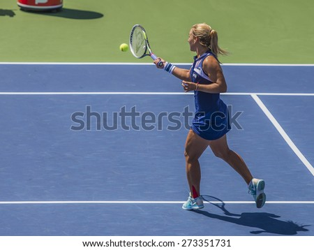 MONTREAL - AUGUST 6: Dominika Cibulkova of Slovakia in her Second round match against Heather Watson of United Kingdom at the 2014 Rogers Cup on August 6, 2014 in Montreal, Canada