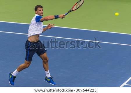 MONTREAL - AUGUST 11: Grigor Dimitrov of Bulgaria during his first round win over Alexandr Dolgopolov of Ukraine at the 2015 Rogers Cup on August 11, 2015 in Montreal, Canada