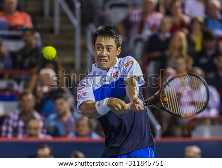 MONTREAL - AUGUST 14: Kei Nishikori of Japan during his quarter final match win over Rafael Nadal of Spain at the 2015 Rogers Cup on August 14, 2015 in Montreal, Canada - stock photo
