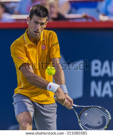 MONTREAL - AUGUST 14: Novak Djokovic of Serbia during his quarter final match win over Ernests Gulbis of Latvia at the 2015 Rogers Cup on August 14, 2015 in Montreal, Canada  - stock photo
