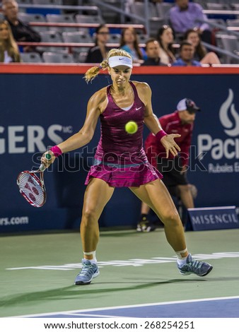 MONTREAL - AUGUST 7: Sabine Lisicki of Germany in her Third round match loss to Agnieszka Radwanska of Poland at the 2014 Rogers Cup on August 7, 2014 in Montreal, Canada