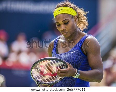 MONTREAL - AUGUST 9: Serena Williams of USA in her semi final match loss to Venus Williams of USA at the 2014 Rogers Cup on August 9, 2014 in Montreal, Canada - stock photo