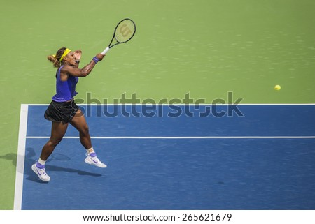 MONTREAL - AUGUST 8: Serena Williams of USA in her third round match win over Caroline Wozniacki of Denmark at the 2014 Rogers Cup on August 8, 2014 in Montreal, Canada