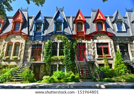 MONTREAL - AUGUST 24: Victorian Houses in Square Saint Louis on August 24th,2013. The square was created in 1876, and named for two businessmen, brothers Emmanuel and Jean-Baptiste Saint-Louis. - stock photo