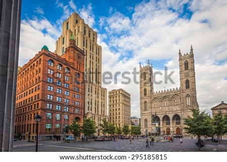 MONTREAL, AUGUST 18:  View of Place d'Armes with the Paul de Chomedey monument, the Notre-Dame basilica and the New York Life and Aldred buildings on August 18, 2014 in Montreal, Quebec. - stock photo