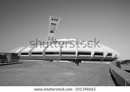 MONTREAL,CANADA -APR.29.The Montreal Olympic Stadium and tower on April 29 , 2012. It's the tallest inclined tower in the world.Tour Olympique stands 175 meters tall and at a 45-degree angle - stock photo