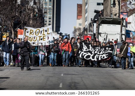 MONTREAL, CANADA   APRIL 02 2015: Riot in the Montreal Streets to counter the Economic Austerity Measures. View of the First line of Protesters walking in the Street