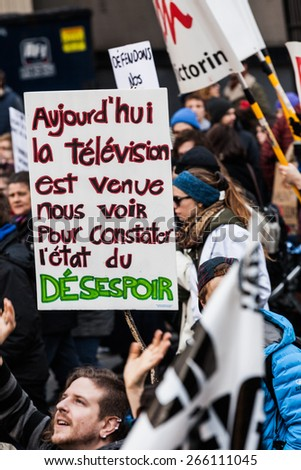MONTREAL, CANADA   APRIL 02 2015: Riot in the Montreal Streets to counter the Economic Austerity Measures. Protesters Holding all kind of Signs, Flags and Placards in the Streets. - stock photo