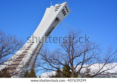 MONTREAL,CANADA  APRIL 17 2016. The Montreal Olympic Stadium and tower. It's the tallest inclined tower in the world.Tour Olympique stands 175 meters tall and at a 45-degree angle - stock photo