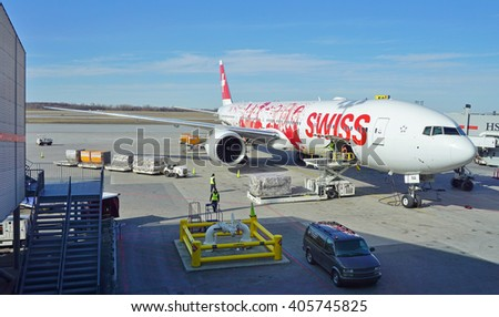 MONTREAL, CANADA -10 APRIL 2016- The newest flagship airplane of Swiss (LX), a Boeing 777-300 painted in a special livery made up of photographs representing airline employees.