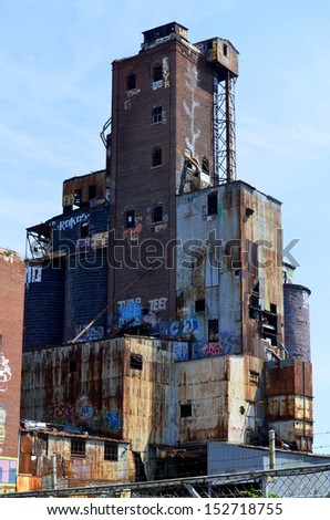 MONTREAL CANADA AUGUST 24: Abandoned Lachine canal grain elevators on august 24 2011 in Montreal Quebec, Canada. Between 1900 and 1930, a total of five grain elevators were built in Montreal. - stock photo