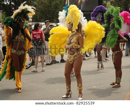 MONTREAL, CANADA - AUGUST 14: dancers in colorful costumes at the Montreal Annual Gay Pride parade August 14, 2011, Montreal. - stock photo