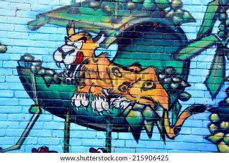 MONTREAL CANADA AUGUST 30: Street art Montreal tiger on august 30 2014 in Montreal Canada. Montreal. is the perfect place to walk in the back alleys and abandoned areas, looking for street art. - stock photo
