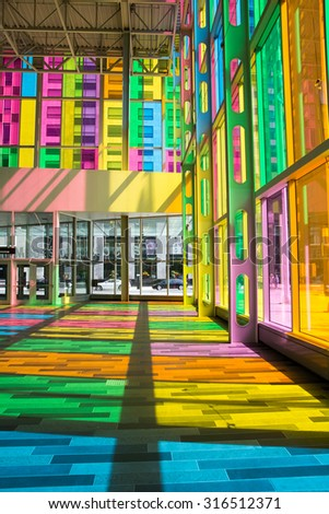 MONTREAL, CANADA - AUGUST 20th 2014: The colourful stained glass Palais des congres de Montreal, a public convention and exhibition centre located in Downtown Montreal, Canada - stock photo