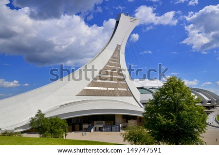 MONTREAL CANADA AUGUST 10: The Montreal Olympic Stadium and tower on august 10 2013. It's the tallest inclined tower in the world.Tour Olympique stands 175 meters tall and at a 45-degree angle - stock photo