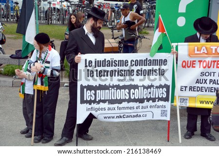 MONTREAL CANADA AUGUST 21:Unidentified people form jewish Hasidic Orthodox Judaism, participating in a rally to condemn the Israel occupation an bombing on Gaza On 08 21 2014 in Montreal Quebec Canada