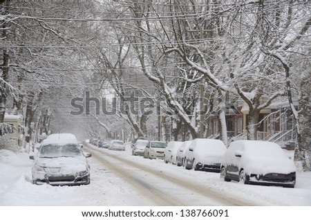 MONTREAL-CANADA DEC. 27:Cars cover of snow on Melrose Street. The snow storm slam Montreal with 45 cm of snow, Canada on December 27, 2012 after knocking out power to thousands of homes in the U.S.