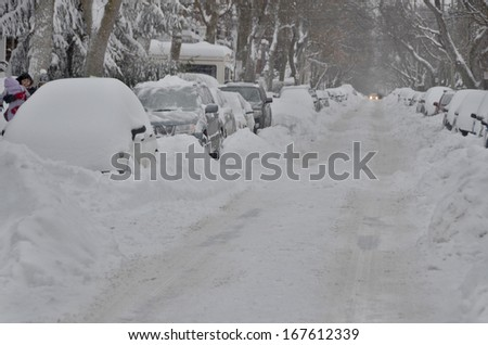 MONTREAL-CANADA DEC. 15:Cars cover of snow on Melrose Street. The snow storm slam Montreal with 35 cm of snow, Canada on Dec. 15, 2013. The winter storm, causing flight delays and traffic problems - stock photo